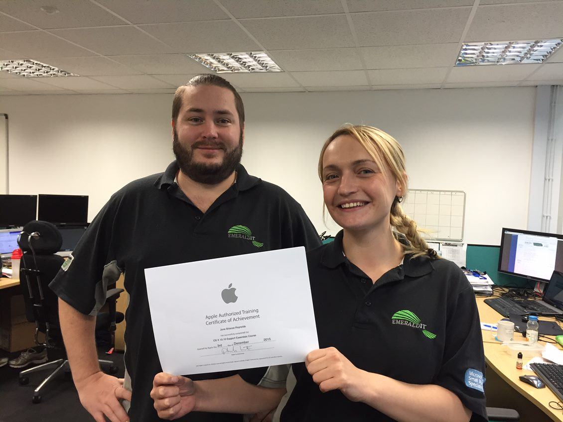 Two Emerald Team Members with new training certificates from Apple