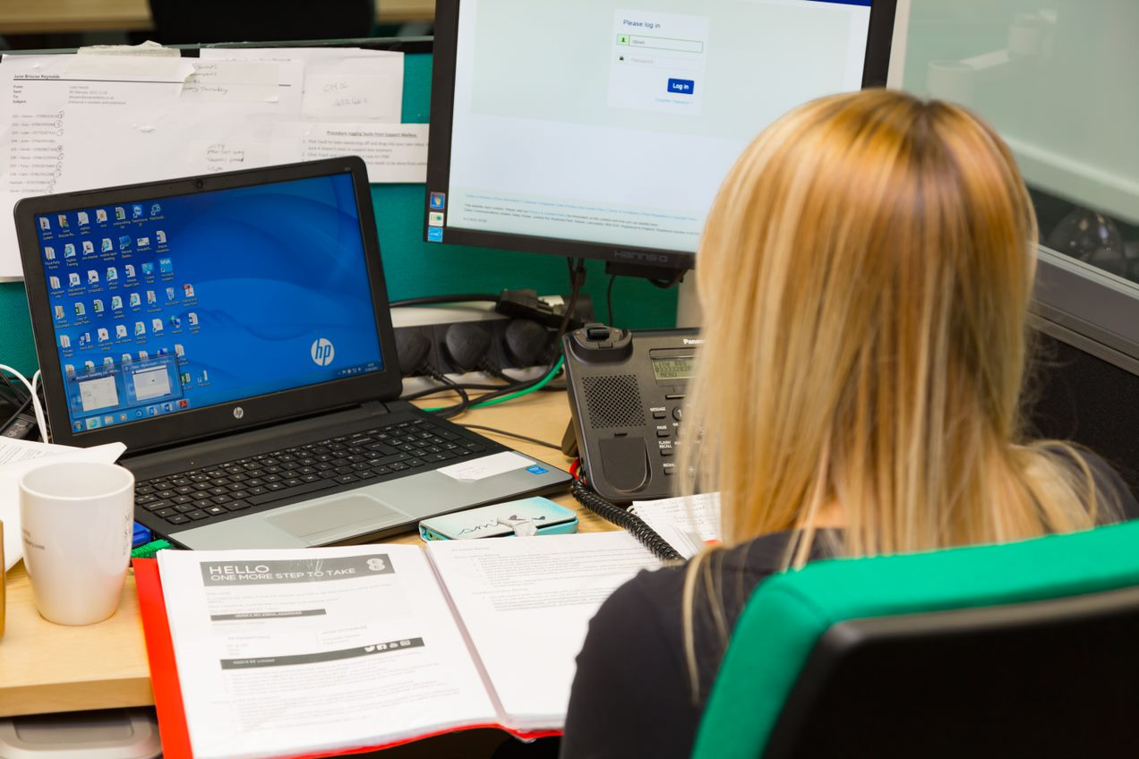 Emerald Engineer at desk supporting customers with disaster recovery procedures